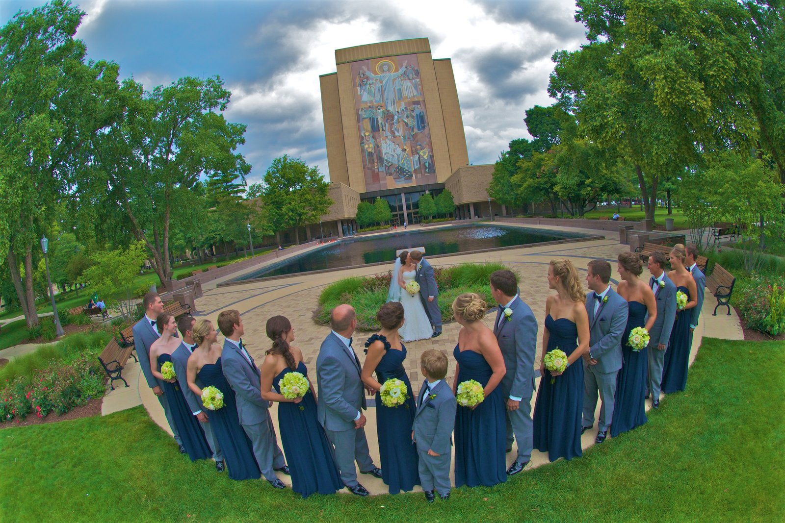 "Bridal Party Portrait on ""God Quad"" in front of Touchdown Jesus and Hessburgh Memorial Library at the University of Notre Dame"