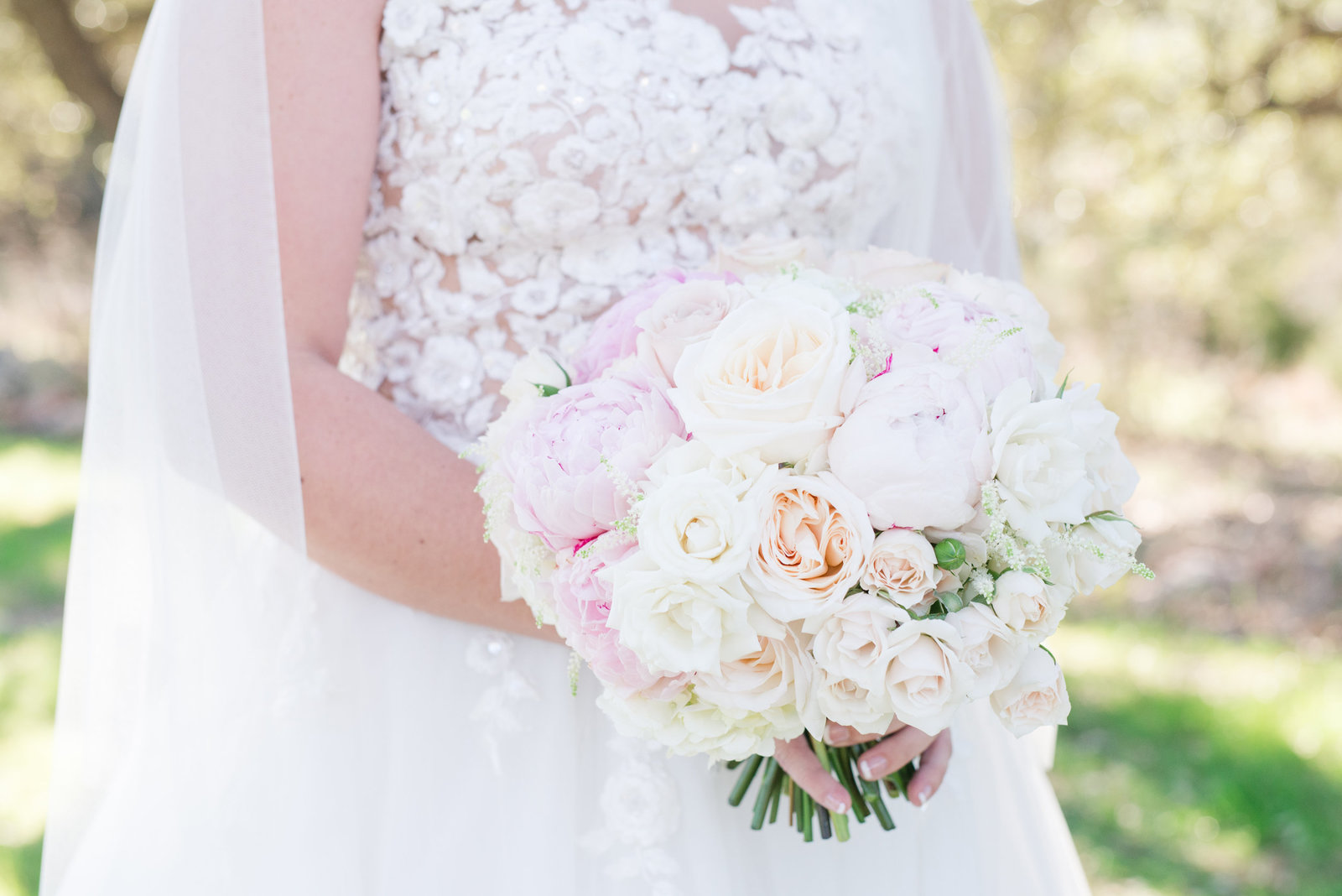 a white and blush wedding bouquet for a bride at The Springs in Georgetown, Texas