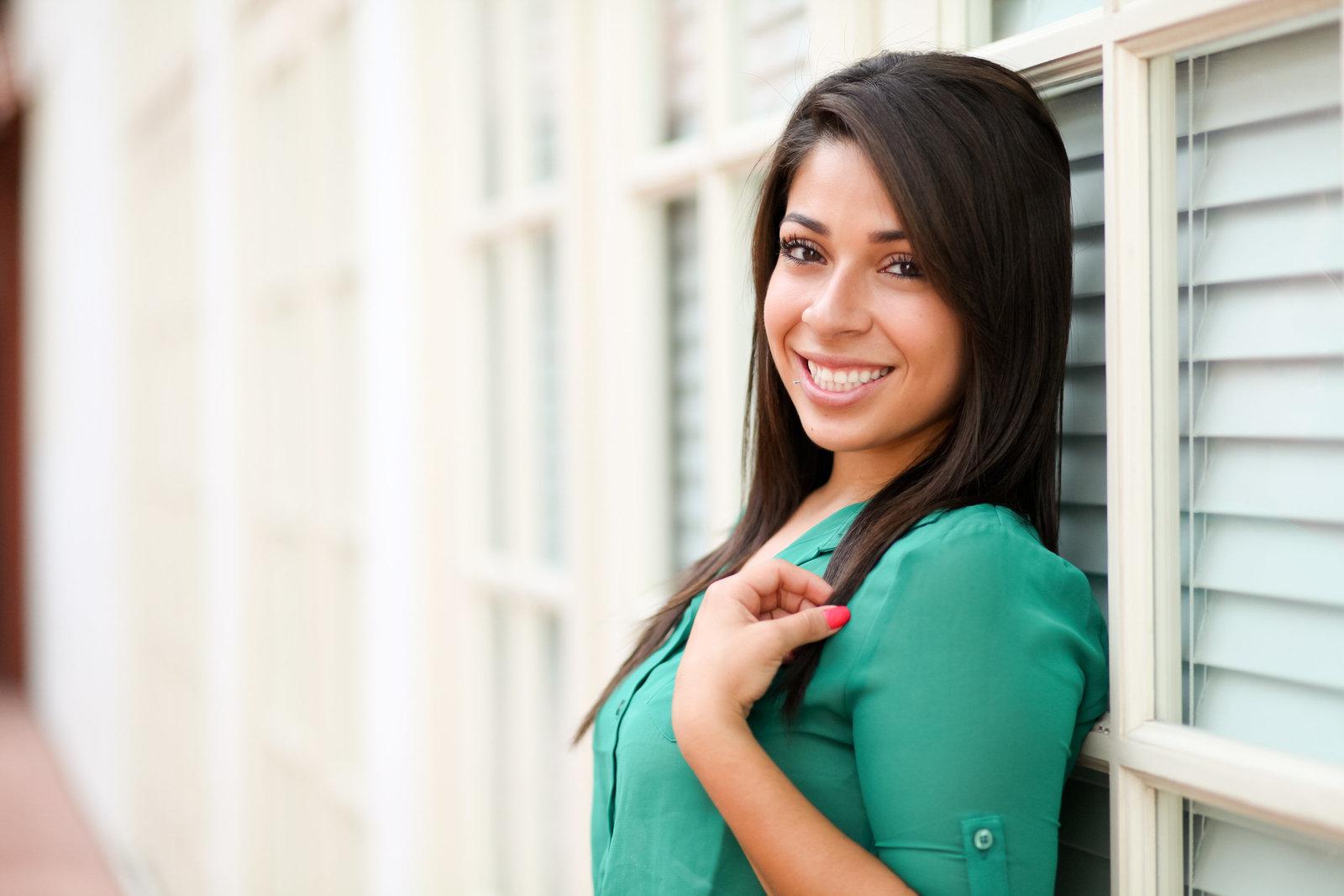 Beaverton high school senior photo against a window | Susie Moreno Photography
