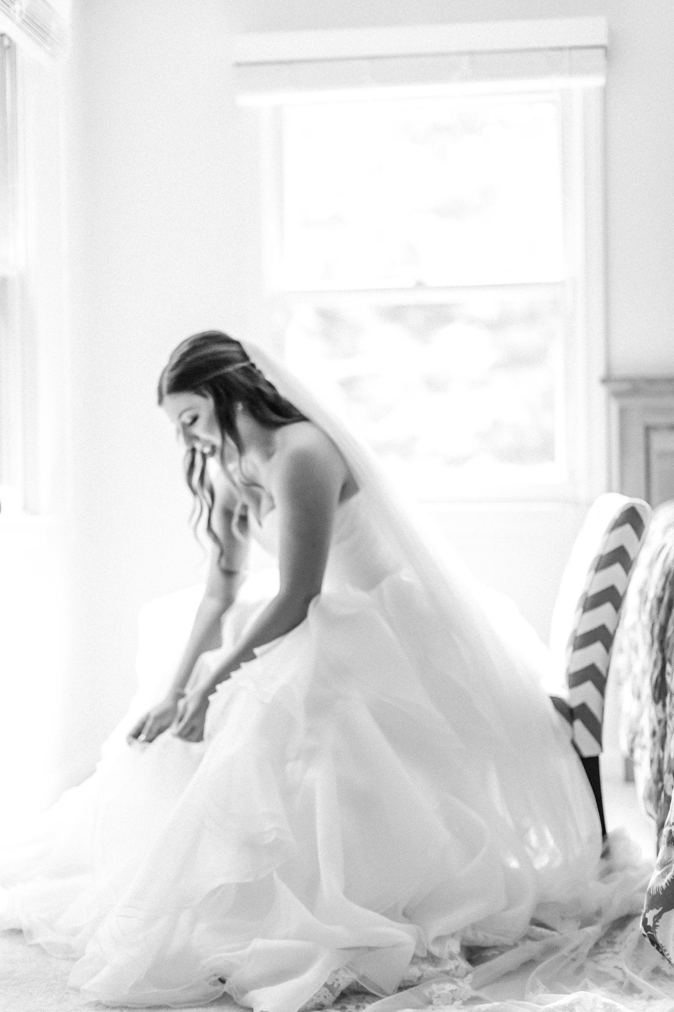 bride getting ready and fixing her dress