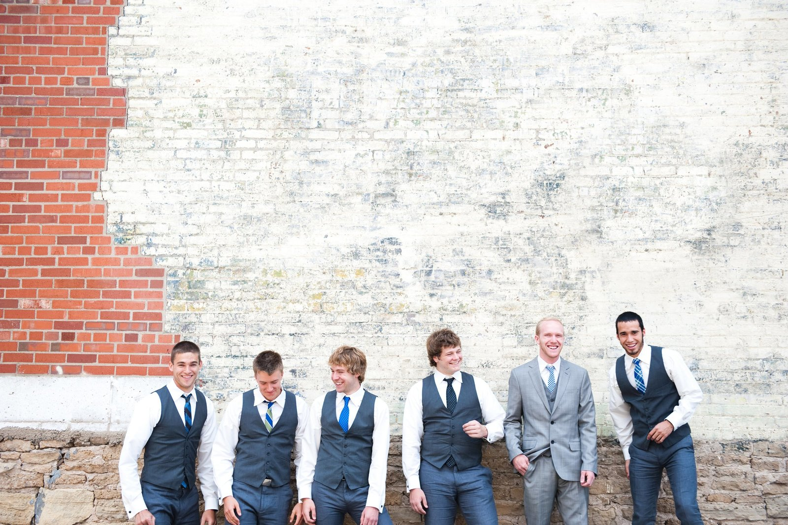 Fargo wedding, groomsmen in Gray suits photographed by Kris kandel