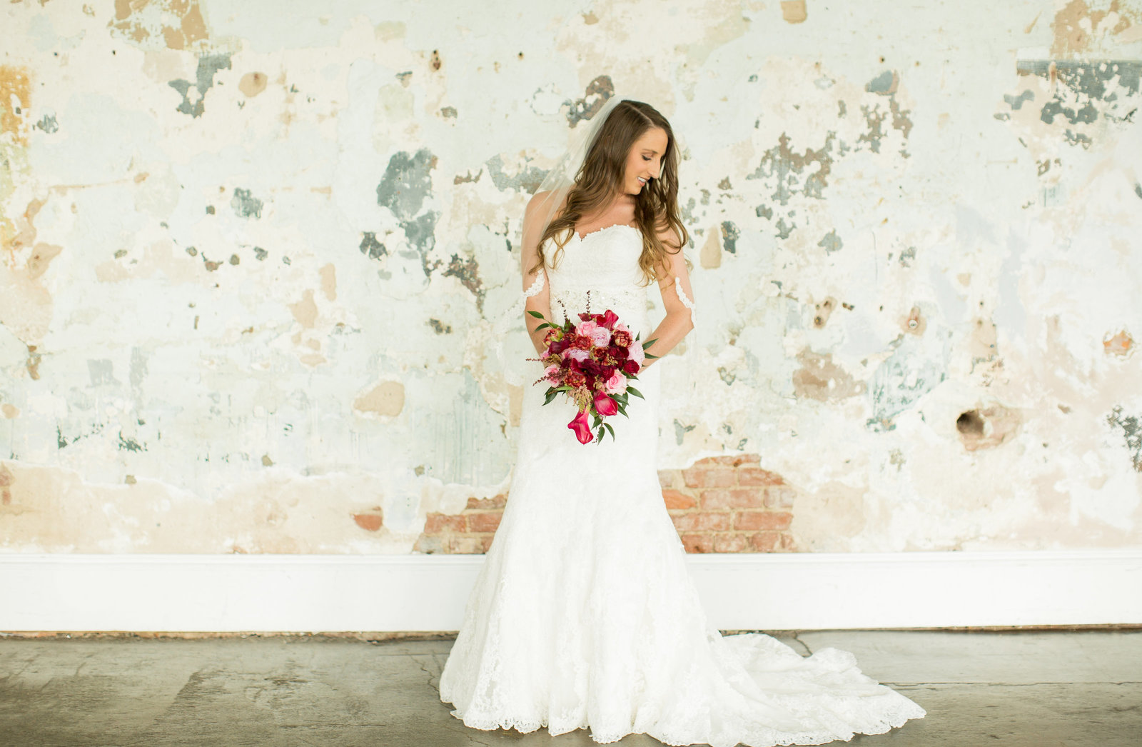 Bride holds bouquet at 701 Whaley Columbia SC