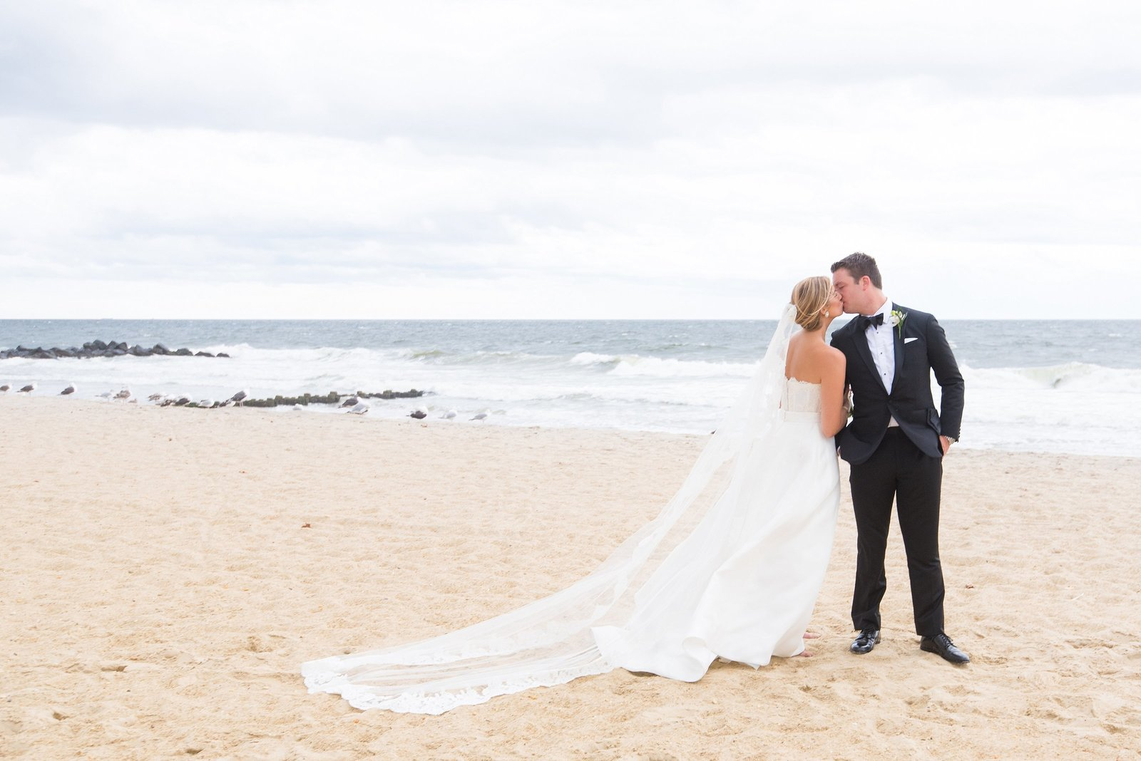 Spring Lake Bath and Tennis Club Bride and Groom Kissing on Beach Photo
