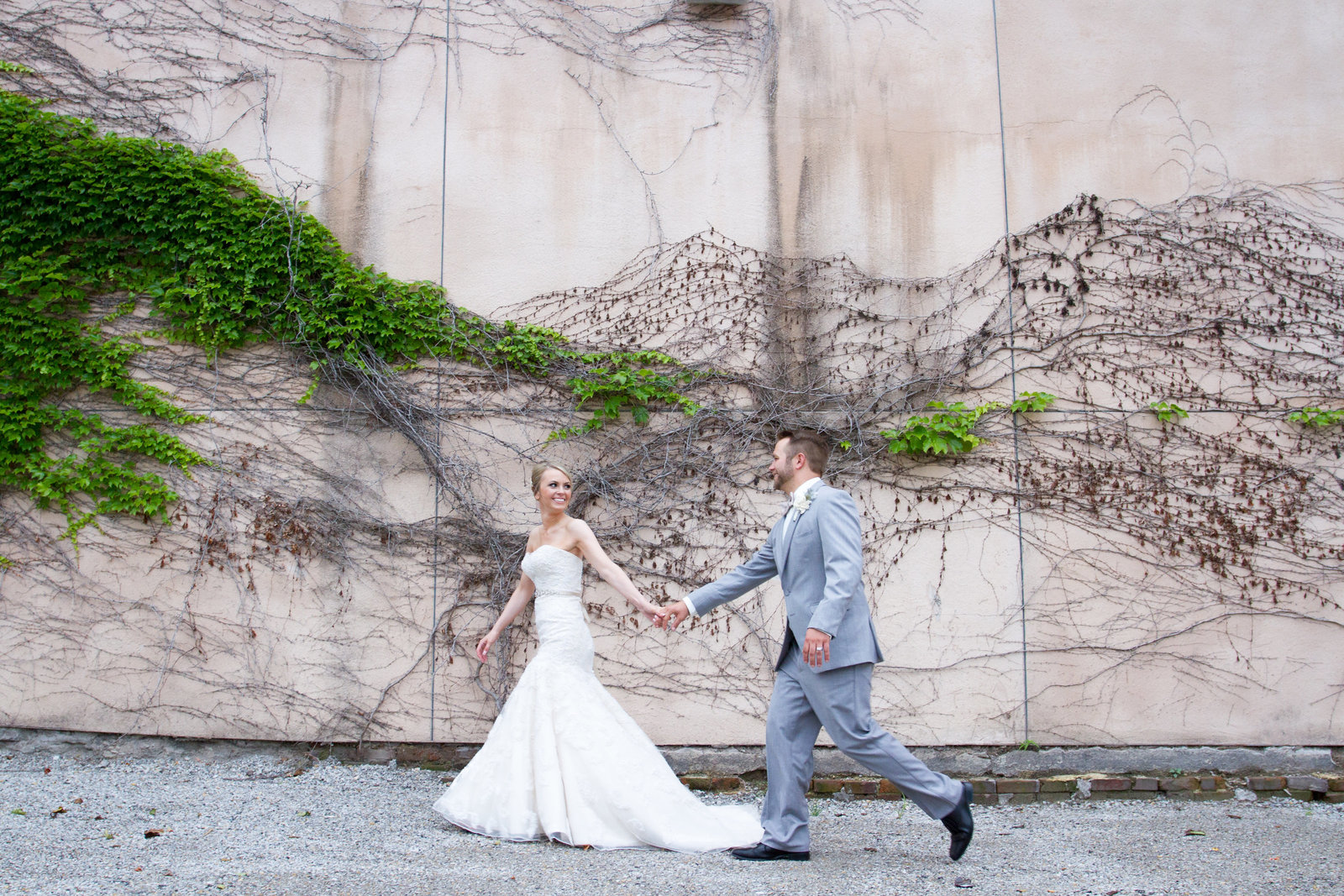 Happy Bride and Groom running in downtown KC.