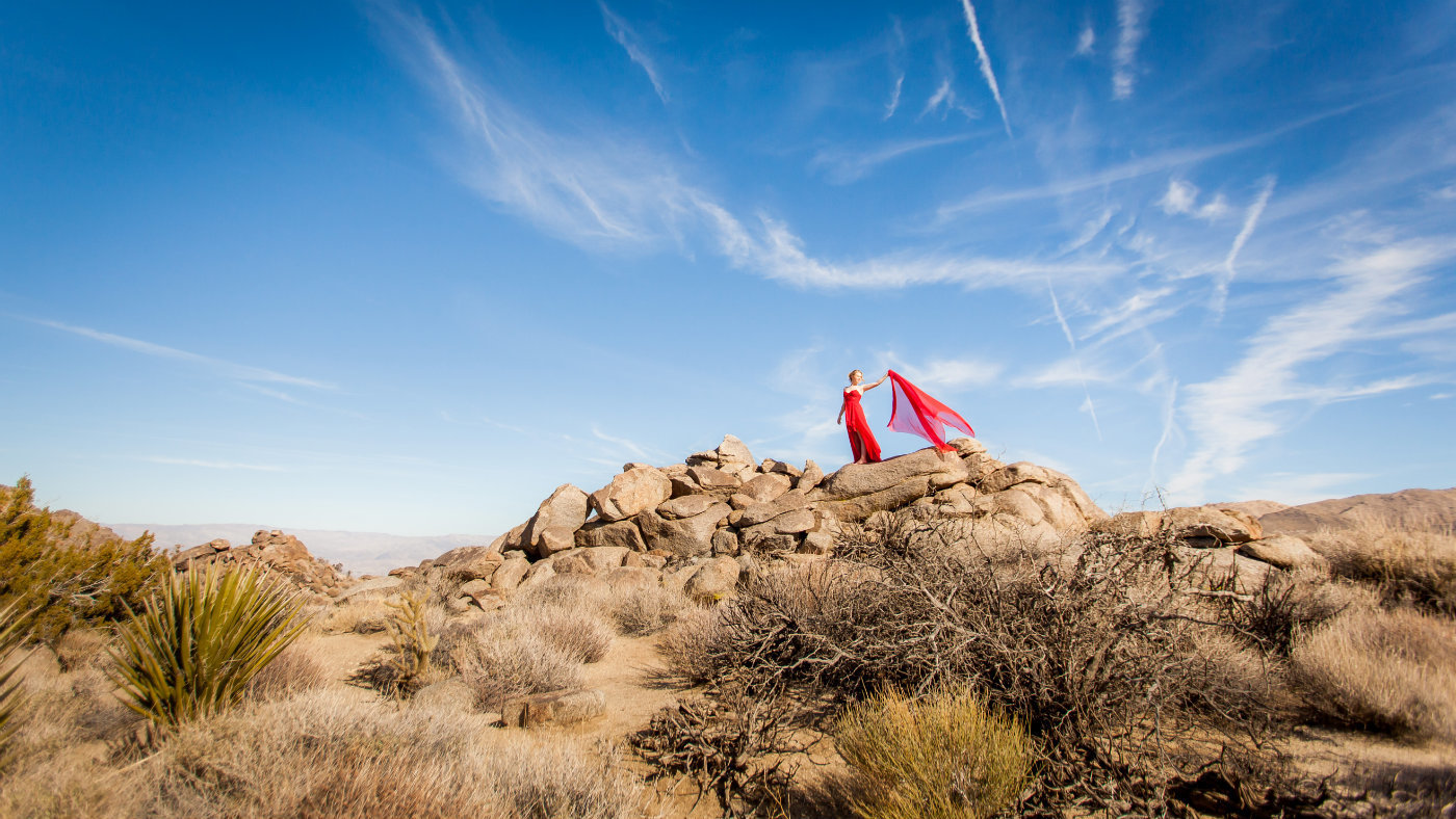 Palm Desert high school senior in red dress on rocks