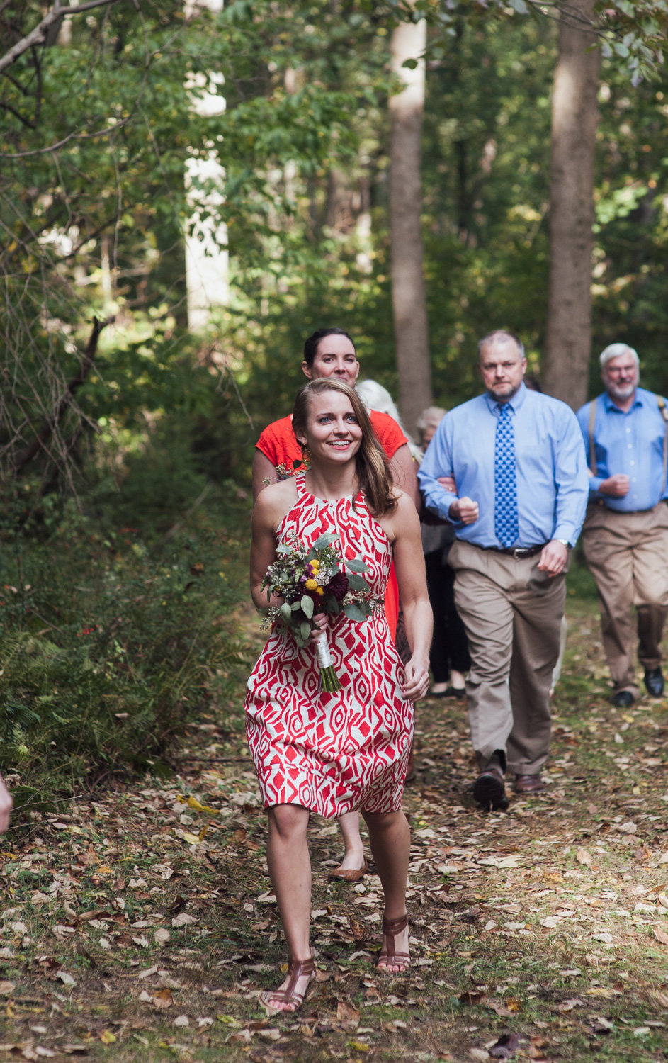 bridesmaid walking to outdoor ceremony