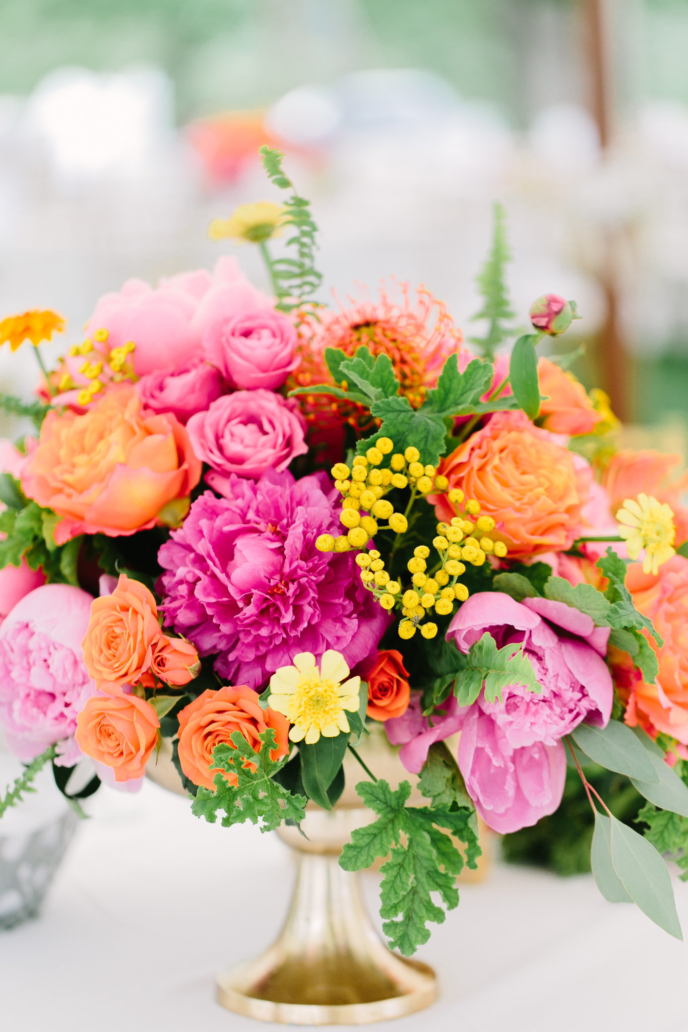 vibrant flower summer  center piece with peonies and roses