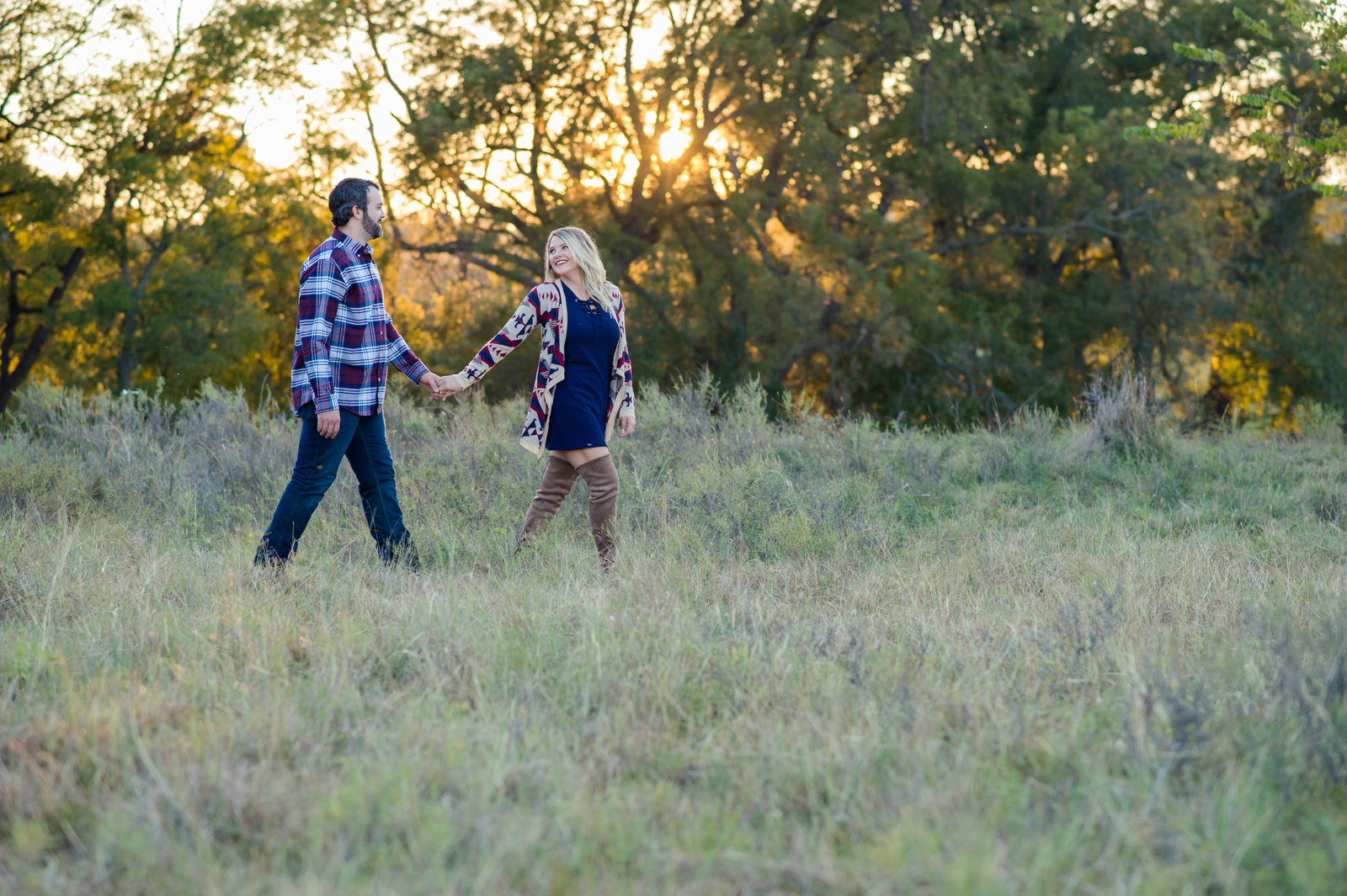 Engagement photo in field by Brittany Barclay Photography