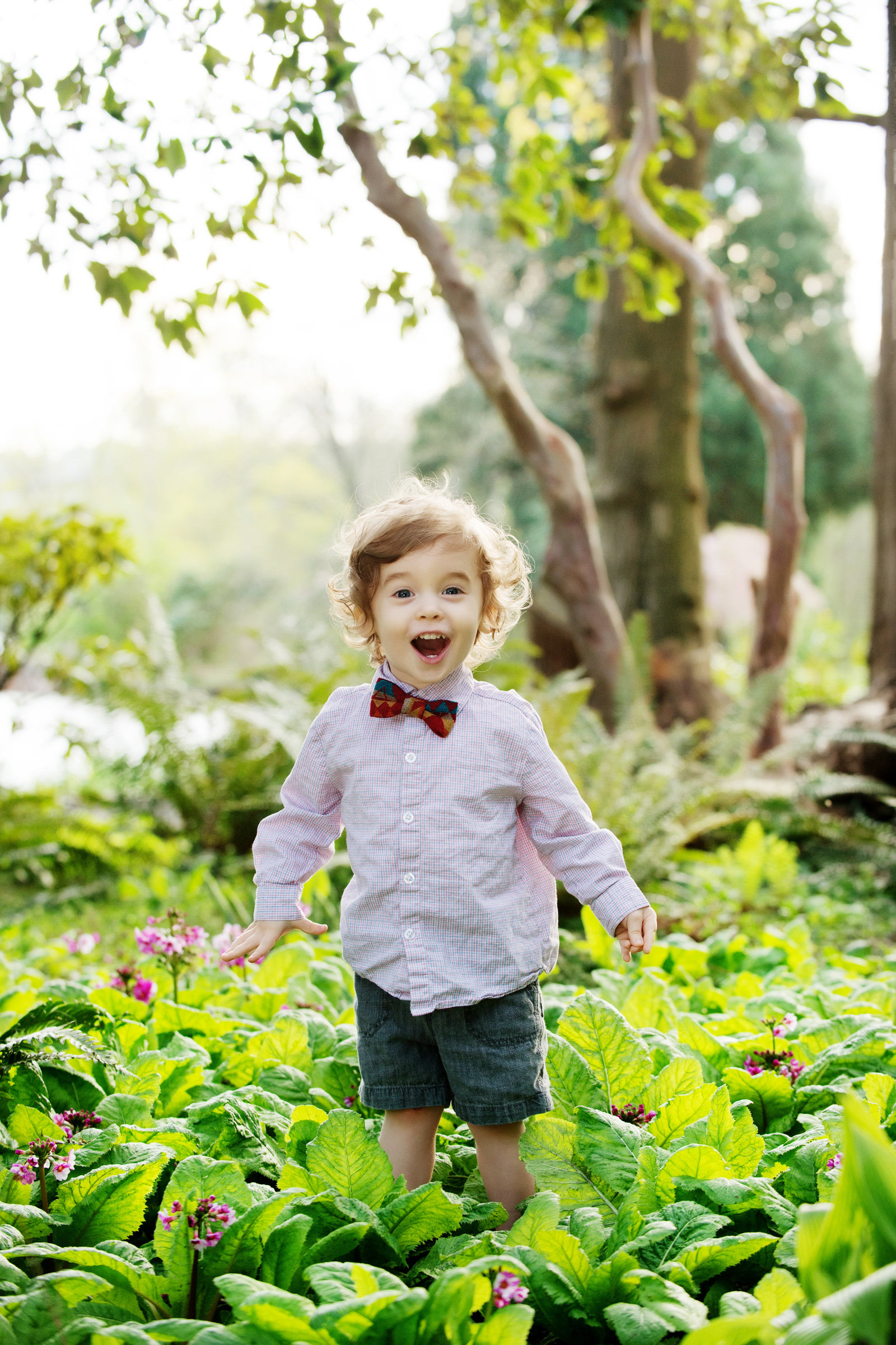 a boy in a bowtie looks really excited at crystal springs rhododendron garden