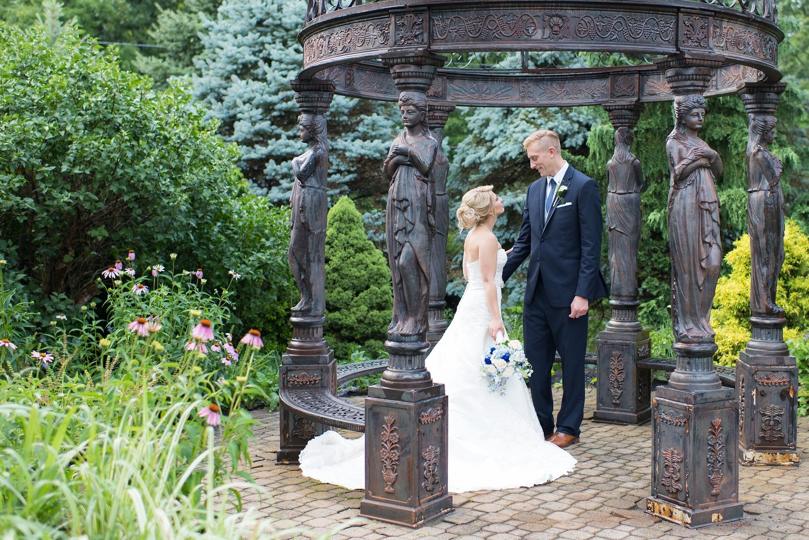 Bride and Groom looking at each other in garden at Villa Borghese Wedding Reception in Wappinger Falls, New York Photo
