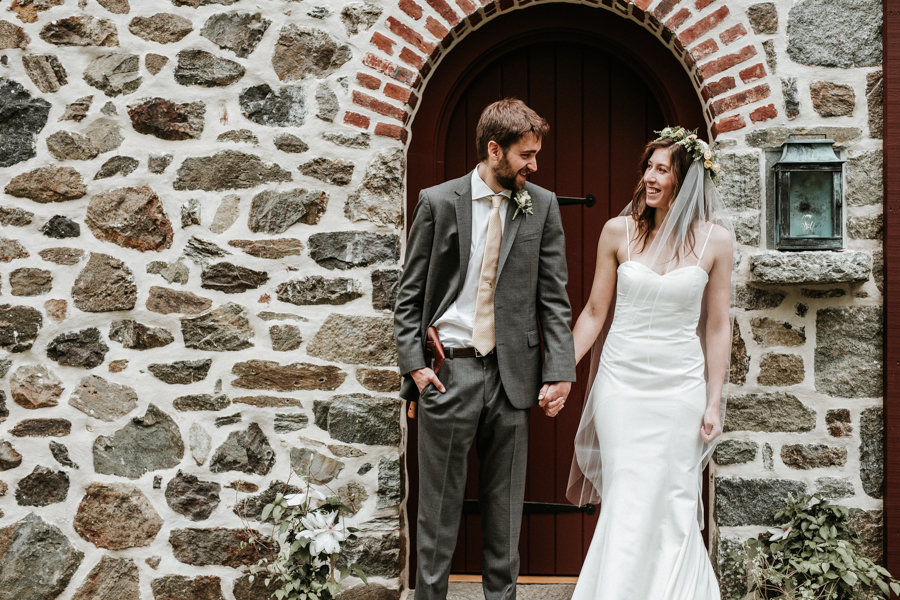 a couple at a stone barn at their wedding in west chester pennsylvania