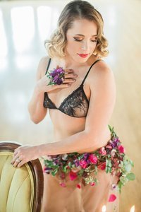 bridal boudoir photo of woman in black forever 21 bra and flower skirt