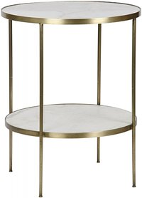 White circular end table with gold legs at Hockman Interiors