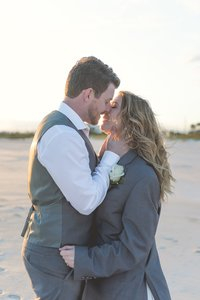 Panama City Beach wedding photographer reviews photo of bride and groom on beach