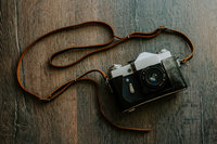 Vintage Camera on wood floor