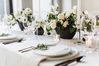 Black and white wedding reception table scape, styled with modern elements.
