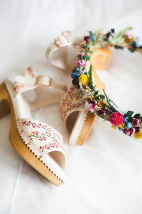 Chic and simple wedding shoes and flower crown from a boho style wedding
