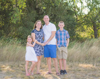 Panama CIty Beach family photographer reviews photo of family