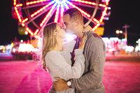 Engagement session at the Saint John fair and exhibition with colourful from ferris wheel taken in Saint John, NB