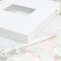 Professionally designed custom wedding album with torn edge paper and slipcase