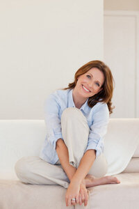 depositphotos_11212694-stock-photo-smiling-mature-woman-sitting-on