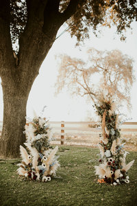 outdoor wedding aisle set up under tree