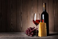 Glass-of-red-wine-with-grapes-bottle-vino-cheese-food-pairing-matching