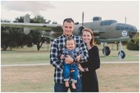 Panama CIty Beach family photographer reviews photo of family at air force base