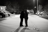 Photo of San Antonio Wedding Photographers Irene Castillo and David Castillo kissing in the snow at night
