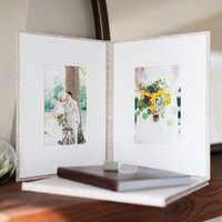 Matted photographic image folios display professional wedding photography