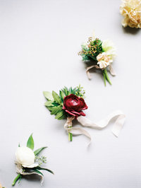 Colored Boutonnieres by Victorian Gardens Floral Design