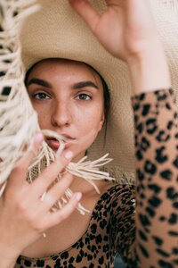 photo-of-woman-wearing-straw-hat-3597100