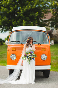 Boho bride on her boho wedding day with vibrant and classic VW van in Antigonish, NS