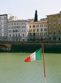 Arno River in Florence with italian flag