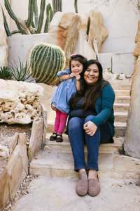 San Antonio Photographer Irene Castillo sitting sitting at the Botanical Garden with her daughter