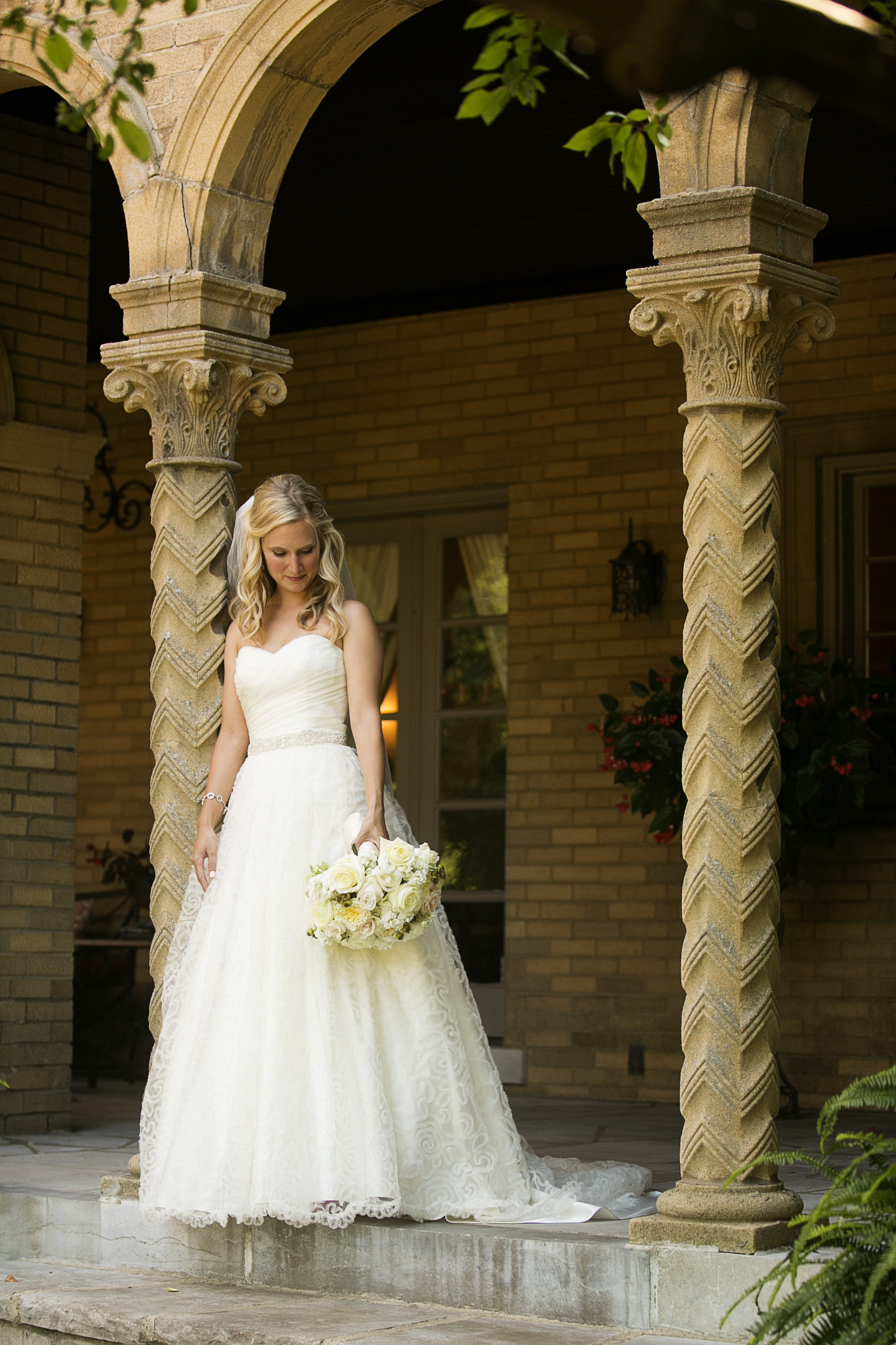 Elegant St. Louis Bride  in timeless white gown with white florals