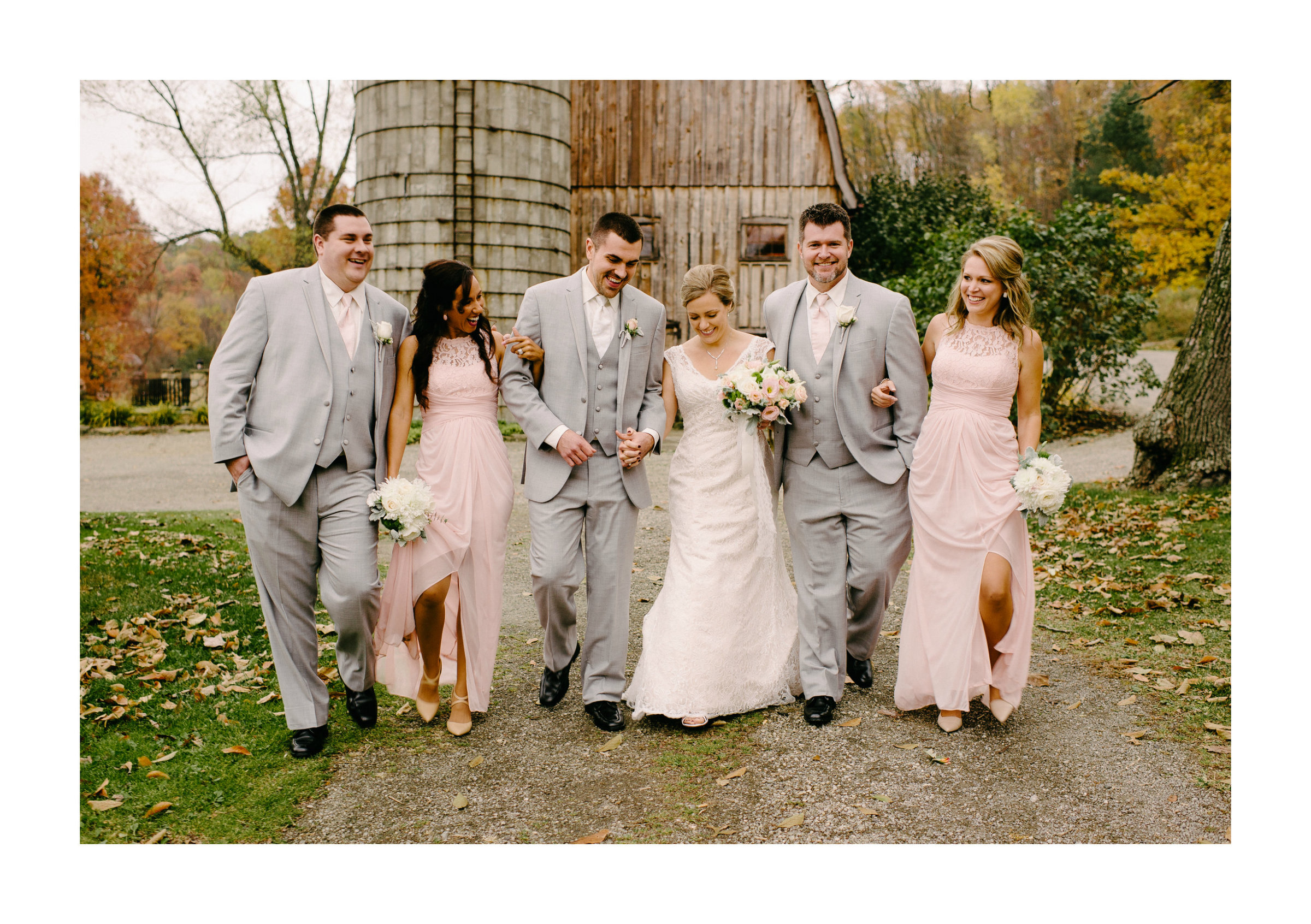 Snodes Restored Barn Bridal party walking in front of Snodes Barn Wedding in Minerva, OH