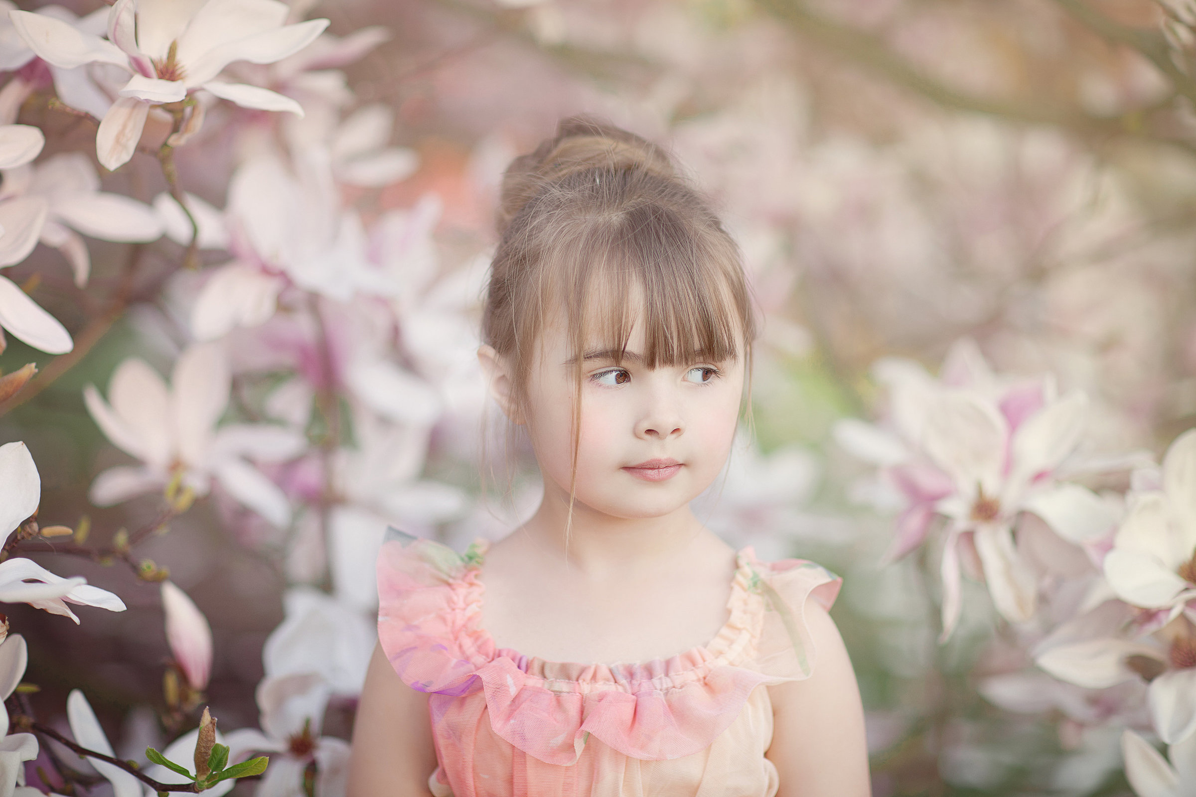 little girl portrait under a magnolia tree