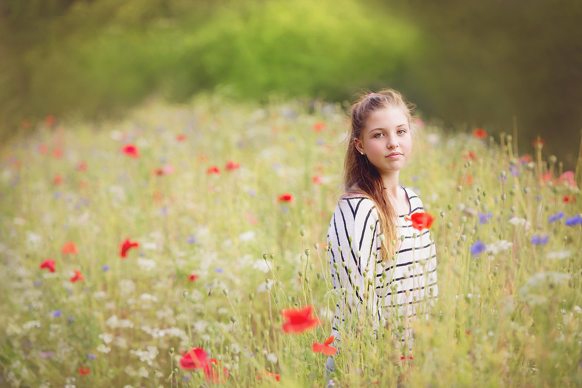 teenage girl in wild flower meadow