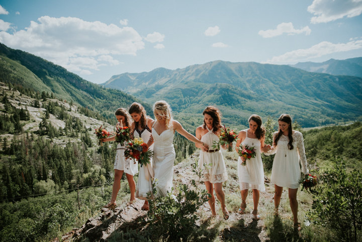 marble colorado wedding, marble colorado wedding photographers, Marble Lodge on Beaver Lake Retreat Campus, breckenridge colorado wedding photographer, white bridesmaids dresses, red bouquets, boho wedding inspiration, colorado wedding photography, mountain wedding photographers, mountain wedding photography, mountain elopement photographers,