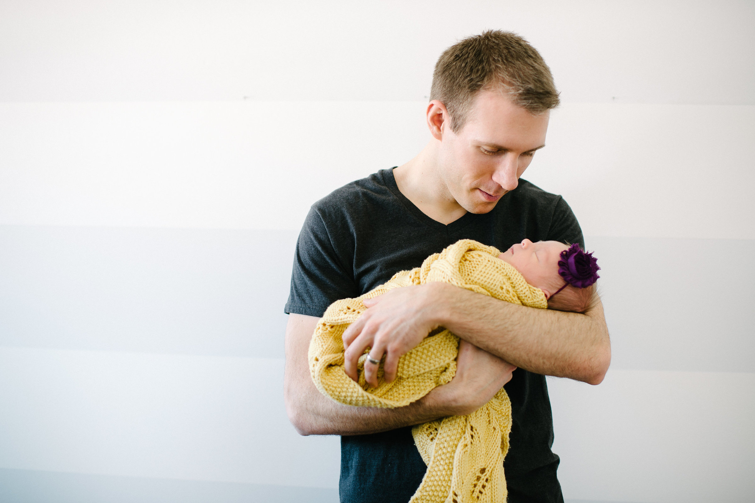 Youngstown OH Lifestyle newborn session dad holding baby