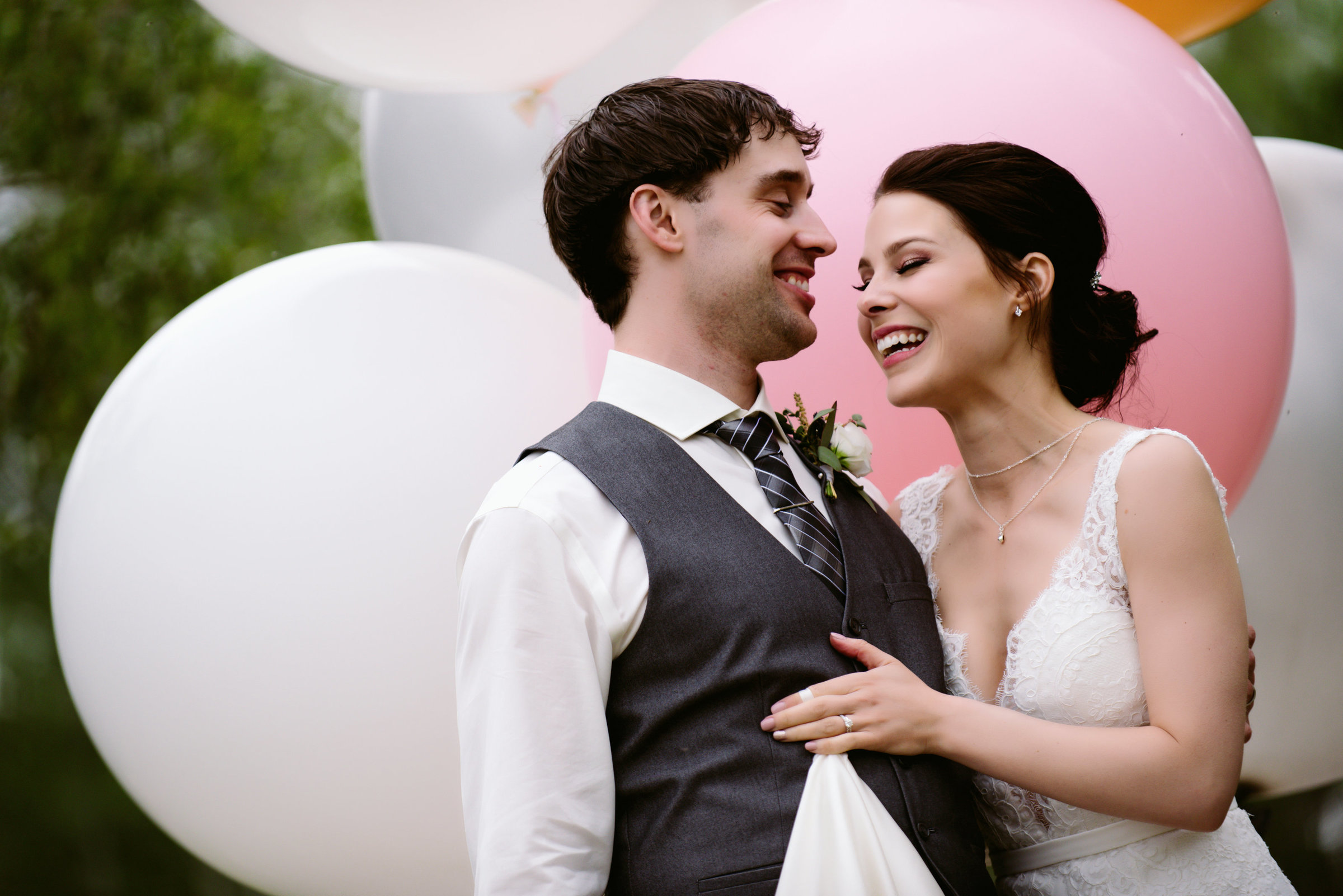 Bride and groom on wedding day with balloons