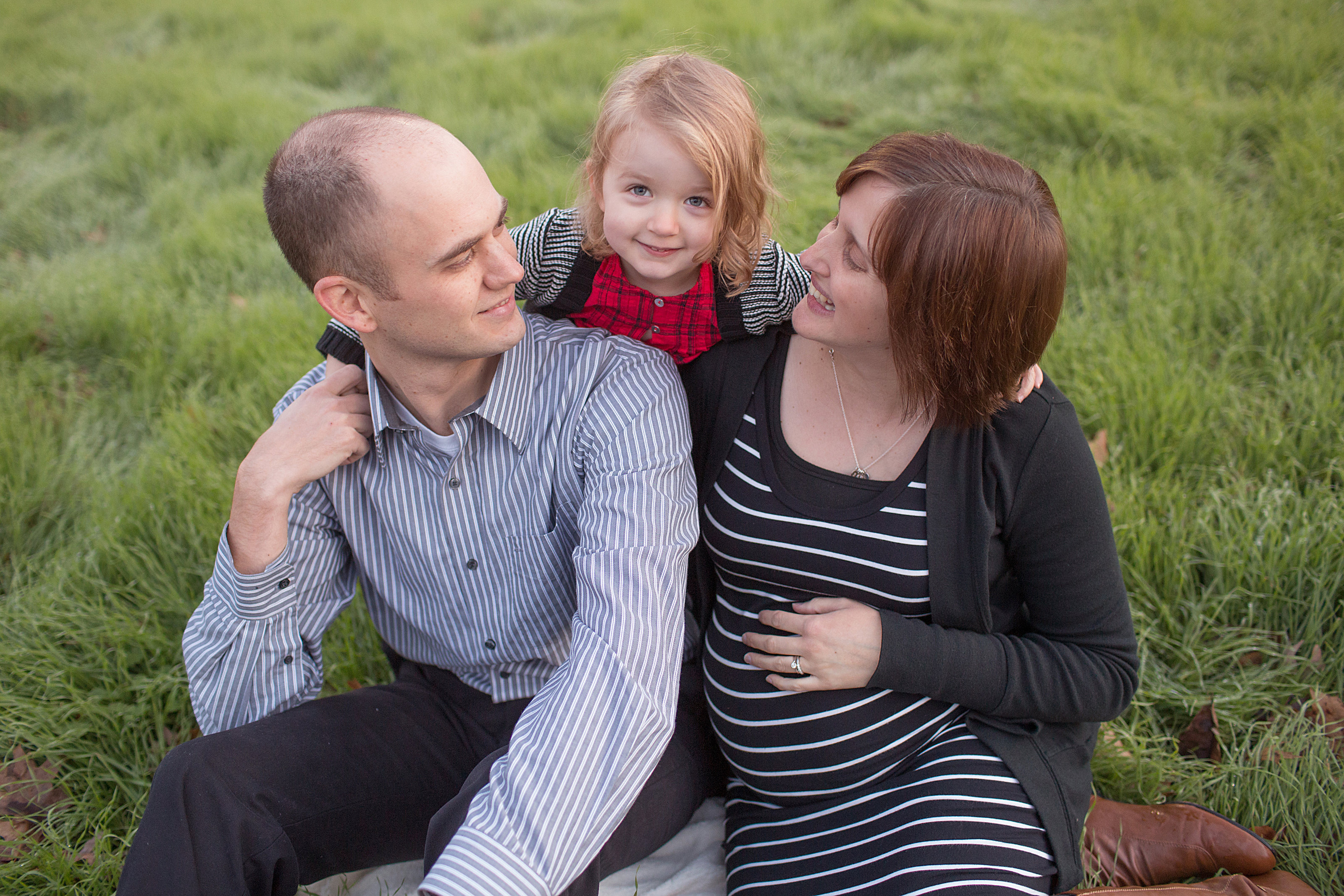 Lancaster family pregnancy sit in grass photo outside