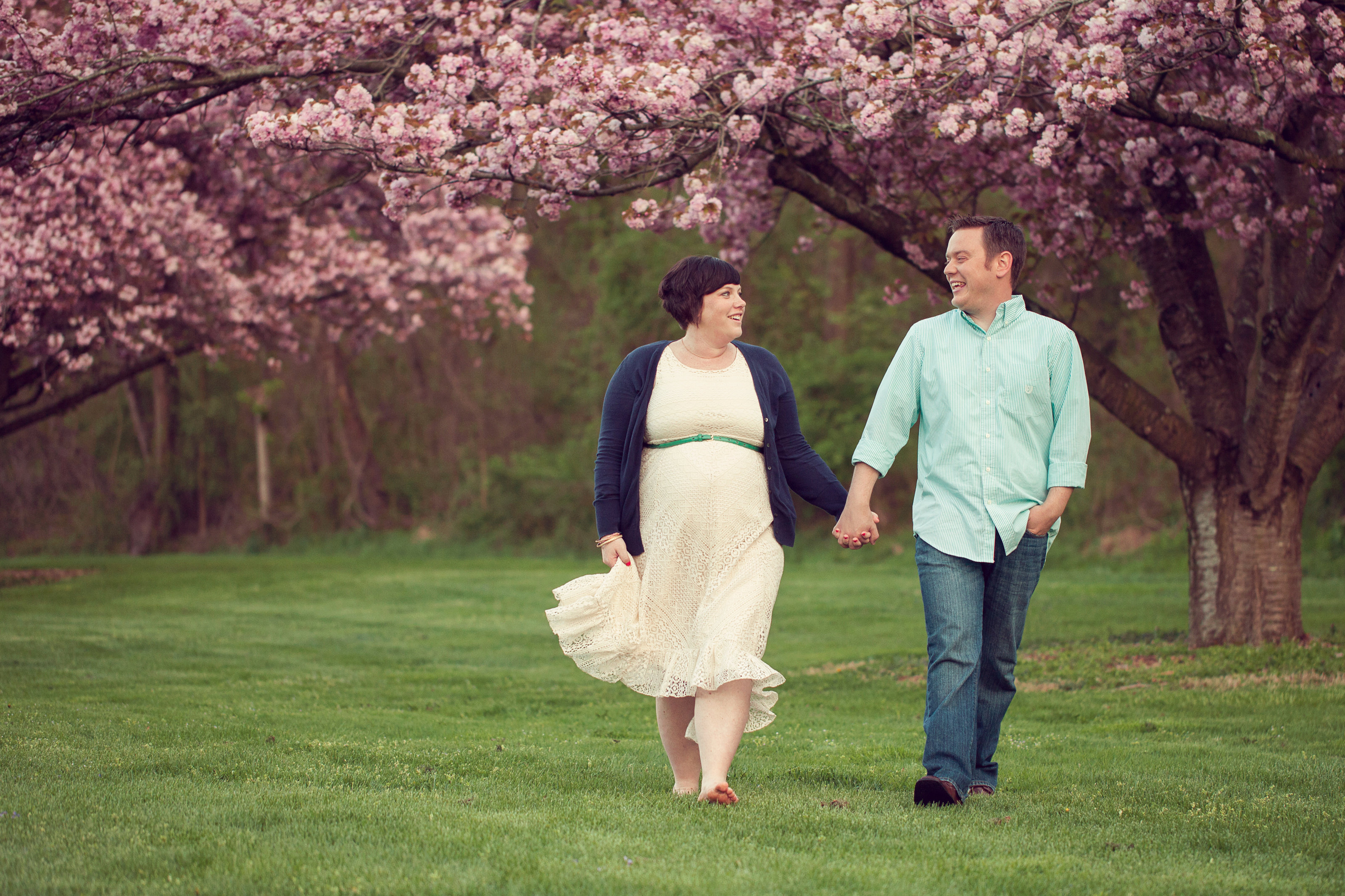 PA spring pregnancy walking pose photo with pink blossoms