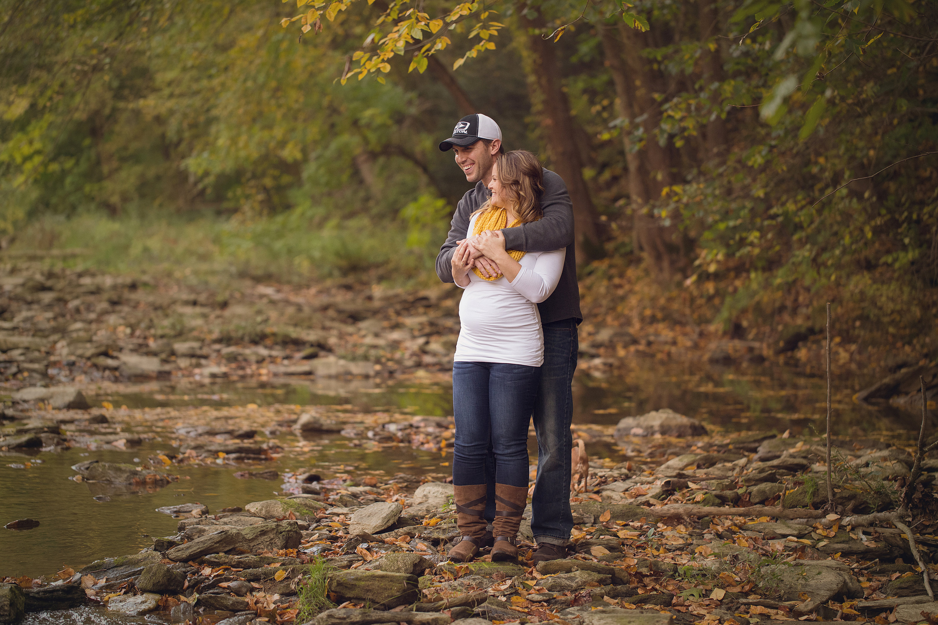 PA autumn maternity couple by stream photo