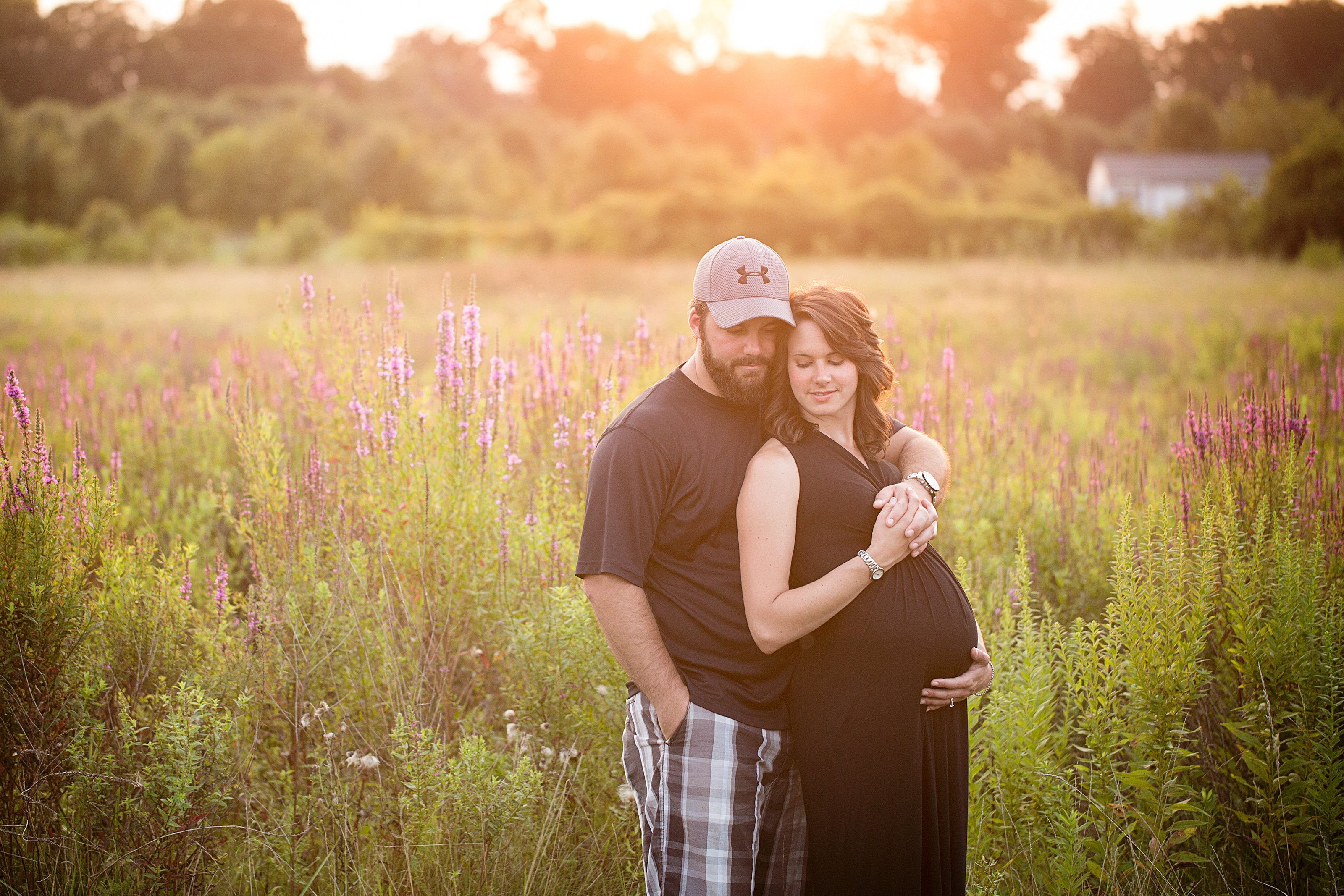 Lancsater maternity couple wear black outfits photo in purple flower field
