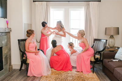 A bride dresses at Chesapeake Bay Beach Club as captured by Ashton Kelley Photography