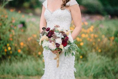 868 Vineyard in Virginia bride with flowers by Nicole Barr.