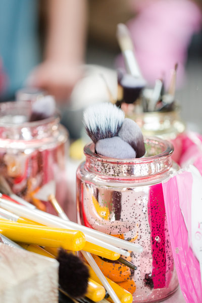 Pink mercury jars hold makeup brushes