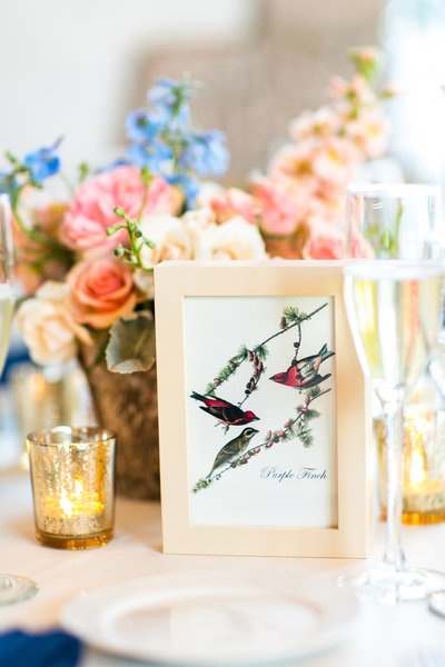 Table setting of wedding inspired by birds and spring flowers
